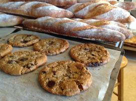 Chocolate chip cookies and fresh baguettes at Bosque Baking Company. Photo by Kenneth Chavez