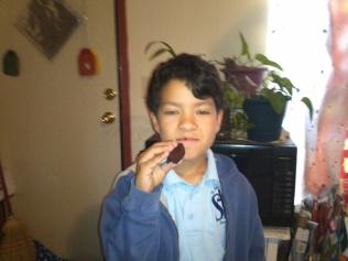 Nico eating Red Velvet Brownies. Photo by Angela