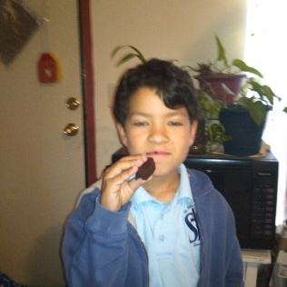 Nico eating Red Velvet Brownies. Photo by Angela