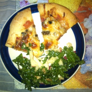 Kale Salad with homemade pizza. Photo by Angela