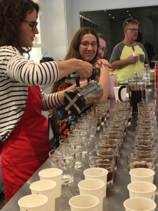 Rachel of Red Rock Roasters pours fresh brewed coffee during a coffee tasting in ABQ, Photo credit: Amy