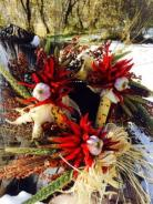 Fall and Christmas wreath with sorghum, wheat, millet, Indian corn, chile pequin, garlic and pinon cones.