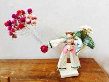 "Example of how I use globe amaranth to create balloons for my ""Balloon Boy"" corn husk doll."