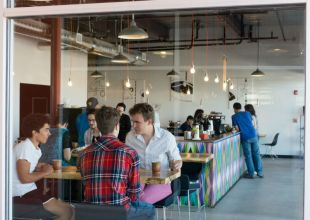 Interior of Prismatic. Photo credit: https://www.signs.com/blog/small-business-success-story-prismatic-coffee/